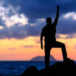 Success achievement running or hiking accomplishment business and motivation concept with man sunset silhouette celebrating with arms up raised outstretched trekking climbing trail running outdoors in nature